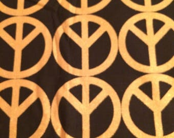 Patty Reed Gold Peace Signs on Black Fabric Remnant  All Cotton 1 yard 44 inches wide