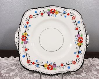 Antique Salt and Nixon Longton Handled Cake Plate - Black Border with Orange, Purple, Yellow and Blue Floral - Ventnor