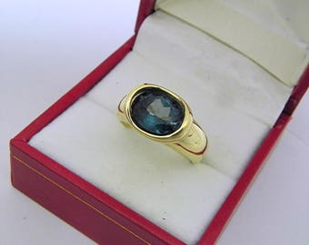 AAAA London Blue Topaz  3.05 carats  10.05x8.02mm in 14K Yellow gold bezel set ring.  0252