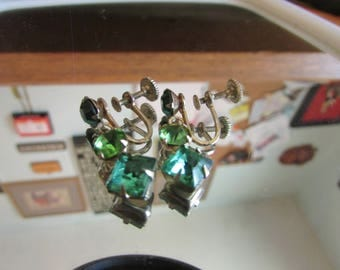 three emerald dangle earrings screw back