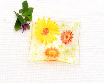 Fused glass art plate, clear with yellow, orange and red flowers