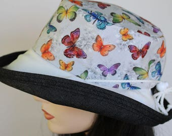 Sunblocker UV summer sun hat with large wide brim featuring lovely gray based butterfly print and adjustable fit