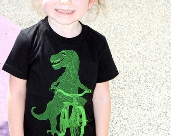 SUMMER SALE Dinosaur on a Bicycle- Kids T Shirt, Children Tee, Cotton Tee, Handmade graphic tee, sizes 2-12