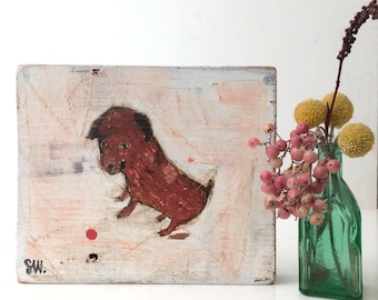 Oil painting on reclaimed wood of a Monty the baby chorkie puppy