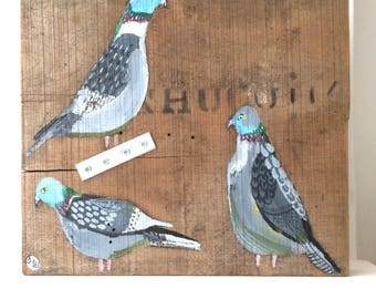 Painting on chunky reclaimed wood of some pigeons.