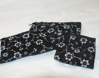 Black with silver glitter and white flowers pouch