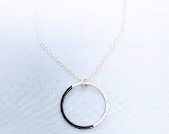 Black and silver circle pendant