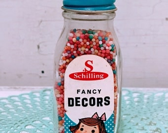 Vintage jar of Schilling fancy decors sprinkles-1950