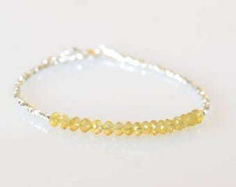 Citrine faceted gemstones beads and sterling silver beads bracelet.