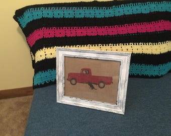 Red Truck with dog on burlap