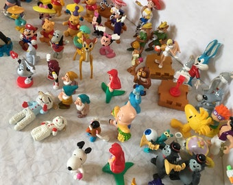 Vintage Collection of 55 PVC Figures Toys Disney Peanuts Warner Brothers Toys.