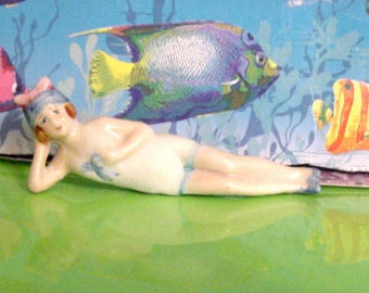 Bisque Bathing Beauty with blue cap and pink bow Figurine