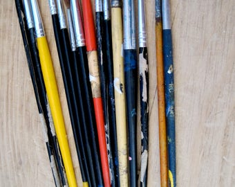 VINTAGE PAINT BRUSHES in a line beat up and old retro and  used
