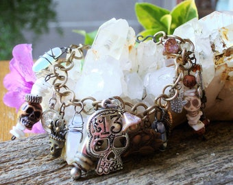 Out of the Garden Came Good and Evil Talisman Charm Bracelet, Skulls, Cats paw, Moonstones, Deaths head, hamsa C 7-5