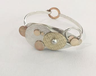 Handcrafted sterling silver, copper and brass bracelet