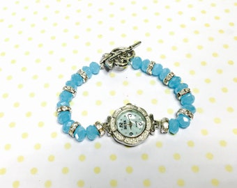 Turquoise Crystal watch/Bracelet silver tone, clear rhinestones, flower clasp, item No. L114