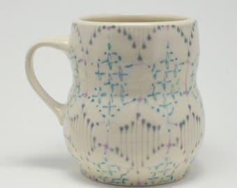 Handmade Wheel Thrown Ceramic Mug with Faded Pink, Grey and Turquoise Pattern