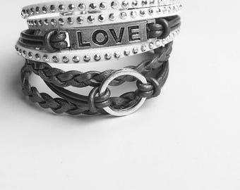 leather bracelet set of two braided bracelets in silver and white with lobster clasp chain closure. infinity circle and LOVE charm.