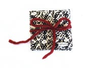 Set of 4 hand-woven black and white Coasters