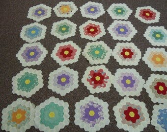 "Quilt blocks  grandmother's flower garden 25  1940's hand pieced well color coordinated cotton blocks  12"" across"