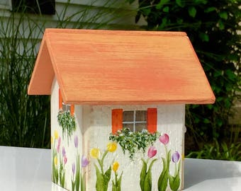 Small decorative rustic terracotta birdhouse
