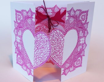 Hand silkscreen printed, locking love hearts and birds, valentines greetings card in pink