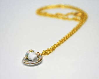 Teacup and saucer gold necklace