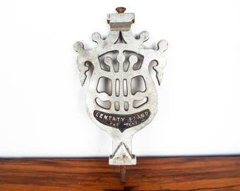 Vintage Silver Metal Lentaty Stand Chrome Emblem