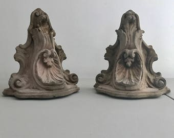 Sold for Caroline Pair of Terra Cotta Brackets