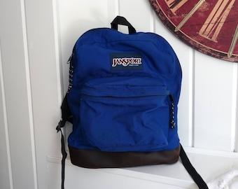 Classic Old School Jansport Cobalt Blue Bookbag Backpack 1980s 1990s Leather Bottom Made in USA Label on Front
