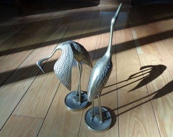 Mid Century Modern Style Pair of Solid Brass Cranes in Very Good Condition with wonderful well developed patina in two different poses