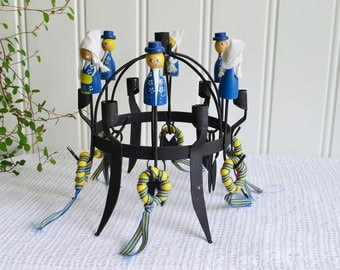 Folk art candle holder , vintage Swedish decorated candlestick, blue and yellow, black metal