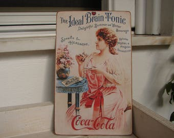shabby chic,Victorian style, coca-cola advertisement,wooden sign,vintage image sealed onto wood