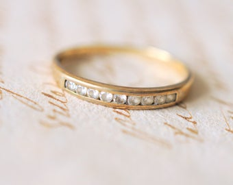 1990's vintage 9k yellow gold cubic zirconia wedding gold band . engagement ring. wedding diamond stacking ring. CZ half eternity ring