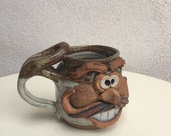 Vintage pottery stoneware mug Man's face teeth and mustache by Eakin