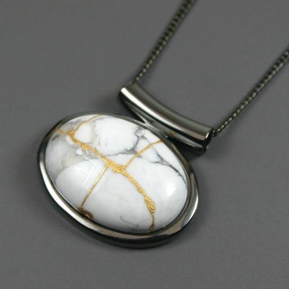 Kintsugi (kintsukuroi) white howlite stone cabochon with gold repair in a gunmetal plated setting on gunmetal chain - OOAK