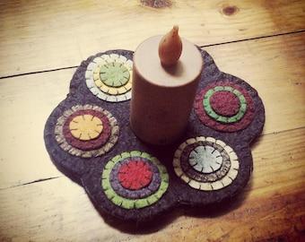 Small penny rug candle mat layered circles various colors