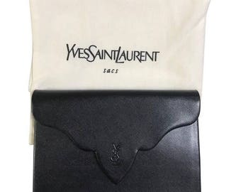 Vintage Yves Saint Laurent genuine black leather clutch purse with beak tip flap and logo stitch motif. Classic YSL bag.