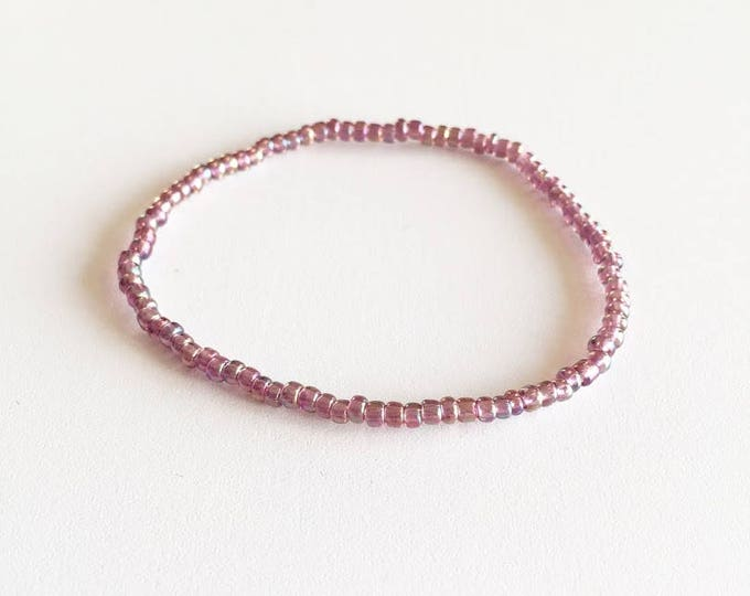 Transparent iridescent purple glass beads bracelet