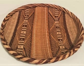 Vintage Round Woven Tray, tribal style decorative arts tray,  coffee table centerpiece, natural fiber home decor housewares