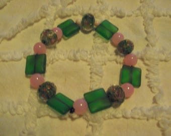 a sweet little bracelet of glass beads in pink and green