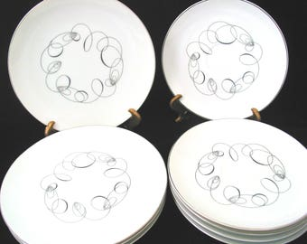 Meito of Japan Tempo Bread Plates and Saucers Vintage 1950s Set of 8 Mid Century Modern Black Spiral Circle Design