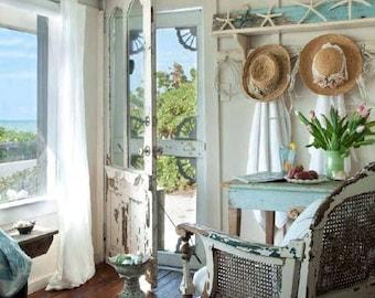 Radiant suncatcher ambiant lighting seashell mirror gilt shell encrusted scallop periwinkle frame ornamental seaside cottage bungalow decor