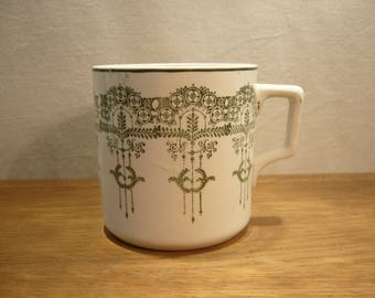 Antique early twentieth century semi-porcelain green and white mug by Clokie & Co of Castleford in Yorkshire