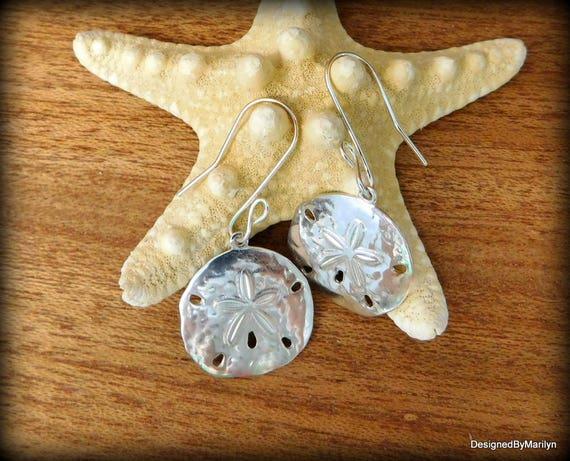 Sterling silver sanddollar earrings, dangle earrings, sea busciut, ocean life earrings, beach style earrings
