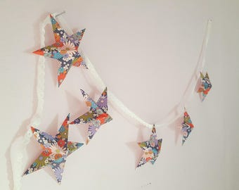 "The ""6 magic stars"" paper Garland in flowers"
