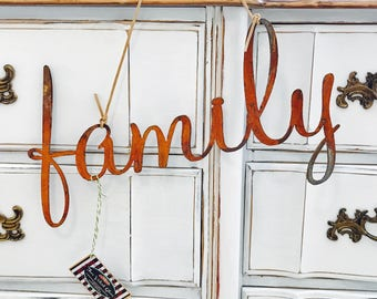 Rusted metal family hanging sign