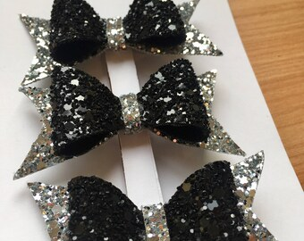 Black and silver glittery hair clips great for party season