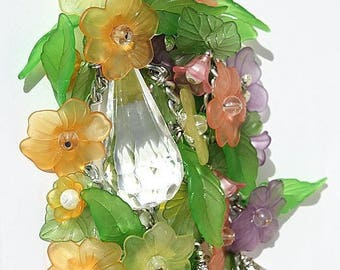 "Jewelry bag composed of multicolored flowers and soft green leaves as well as glass beads: ""Floral Cascade"""