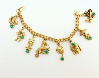 Oriental Asian Theme Charm Bracelet with Green Rhinestones Dragon Rickshaw Etc.